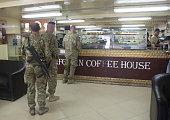 People queue inside the Afghan Coffee House near the US accommodation blocks at Kandahar airfield on November 14 2014 in Kandahar Afghanistan Now...