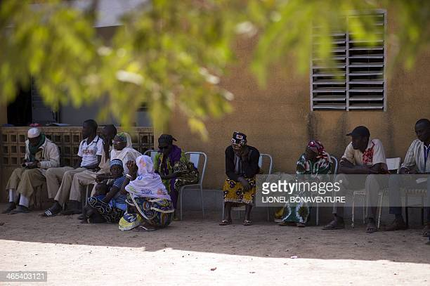 People queue on January 25 2014 to see an ophthalmologist in Leo Burkina Faso The French cosmetics company L'Occitane has been working with women...