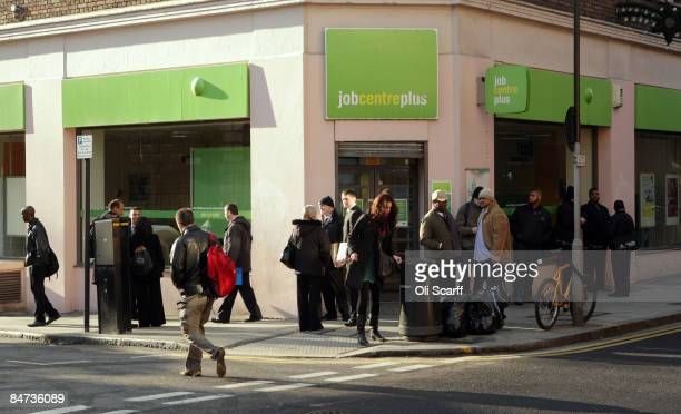 People queue outside a branch of the Job Centre Plus on February 11 2009 in London England Official Government figures released today show that UK...