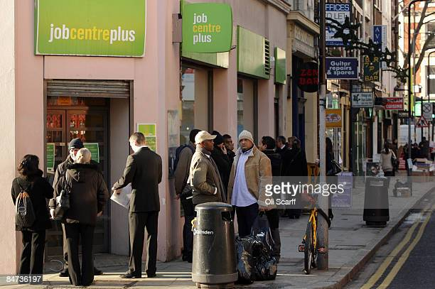 People queue outside a branch of the Job Centre Plus on February 11 2009 in central London England Official Government figures released today show...
