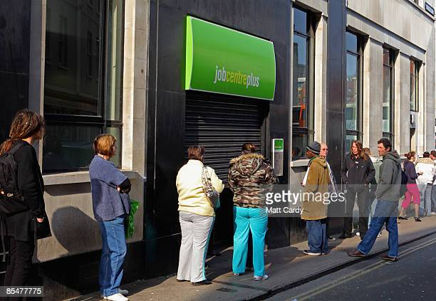 People queue outside a Job Centre on March 18 2009 in Bristol England Official figures published today show that UK unemployment has risen above two...