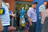 People queue outside a supermarket in Caracas taken over by National Guard in Caracas Venezuela on February 5 2015 President Nicolas Maduro whose...