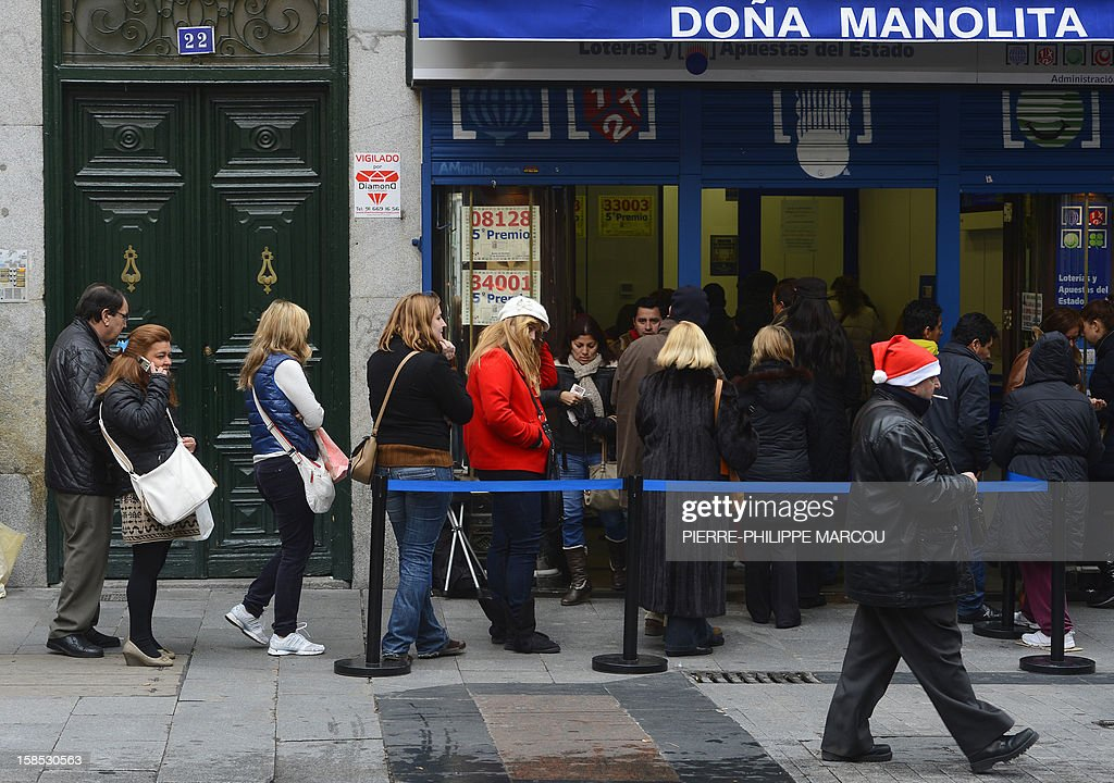 People queue outside the famous lottery's office Dona Manolita to buy the 'Fat One' (el Gordo) lottery tickets in the centre of Madrid on December 18, 2012. On December 22, thousands of lucky ticketholders in Spain could find some relief from the country's economic crisis as the world's richest lottery will pay out more 2,52 billion euros in prize money. Spain's Christmas lottery named 'El Gordo' (Fat One) is a Christmas tradition in Spain and is the world's biggest lottery in terms of the total sum paid out.