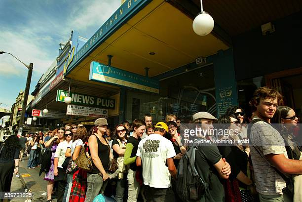 People queue patiently in King Street Newtown to buy tickets for the upcoming U2 concert SMH NEWS Picture by KATE GERAGHTY