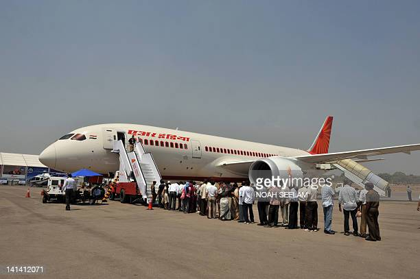 People queue to board a newly inducted Boeing 7878 series Dreamliner the India Aviation2012 show at Begumpet airport in Hyderabad on March 16 2012...