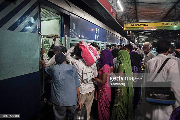 People queue to board the AboharJodhpur passenger train also known locally as the 'Cancer Express' in Bhatinda Punjab India on Wednesday Aug 28 2013...