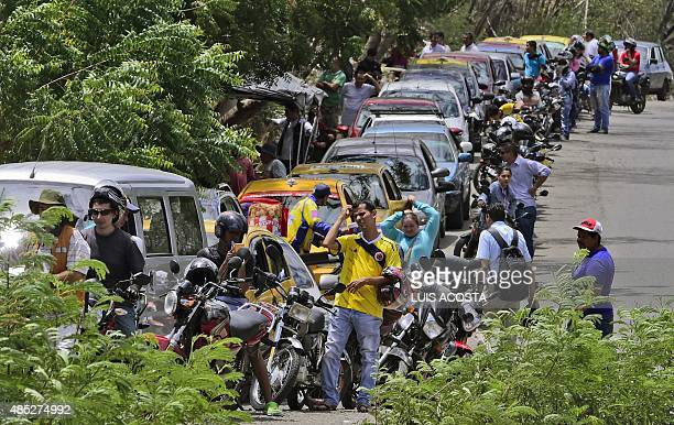 People queue to buy gas on August 26 2015 in Cucuta North of Santander Department Colombia as the border crisis with Venezuela is causing shortages...
