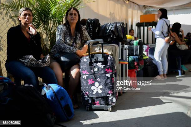 People queue to buy tickets to travel to Ecuador at a bus terminal in Caracas on October 11 2017 as scores of disappointed Venezuelans who see no end...