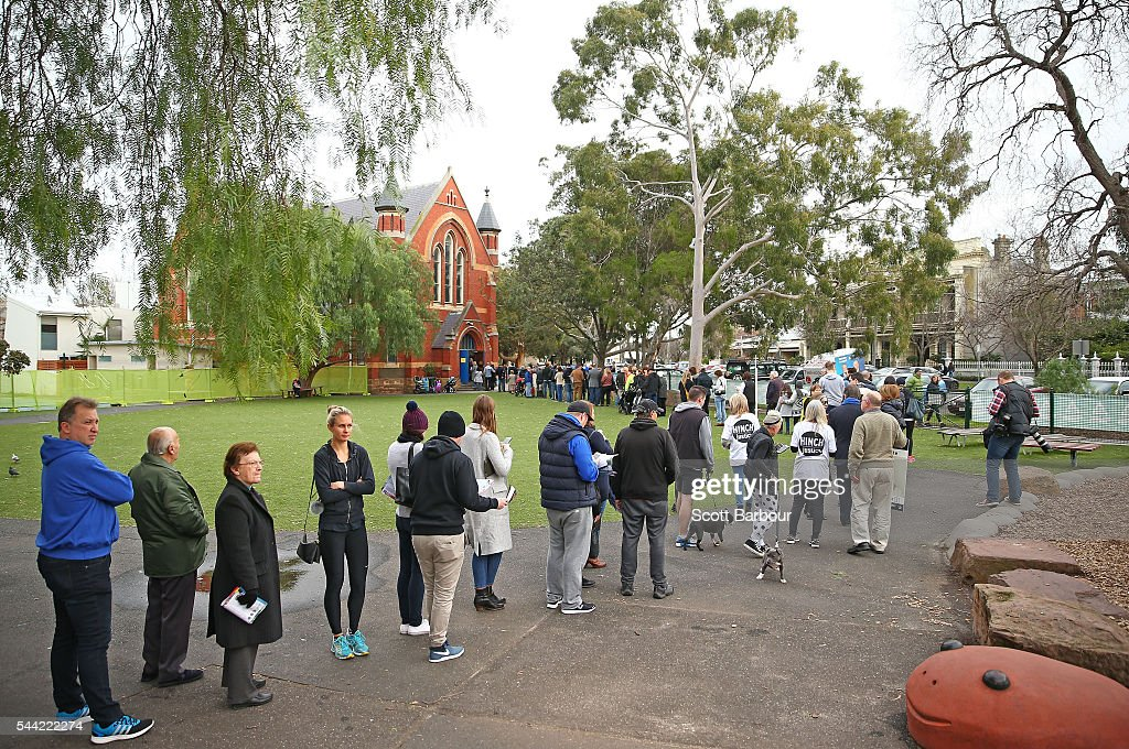 People queue to cast their vote in the national election at a polling station at at Albert Park Primary School on July 2, 2016 in Melbourne, Australia. Voters head to the polls today to elect the 45th parliament of Australia.