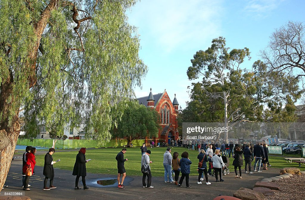 People queue to cast their vote in the national election at a polling station at Albert Park Primary School on July 2, 2016 in Melbourne, Australia. Voters head to the polls today to elect the 45th parliament of Australia.