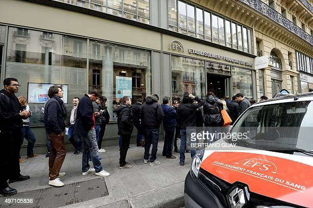 People queue to donate blood at a blood bank in Paris on November 14 2015 following a series of coordinated attacks in and around Paris late November...