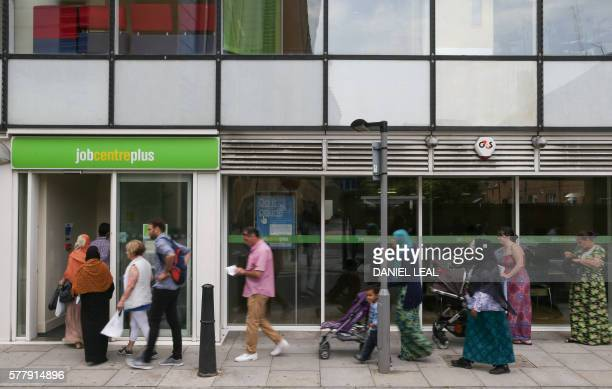 People queue to enter a job centre in east London on July 20 2016 Britain's unemployment rate dipped to 49 percent in the three months to May the...