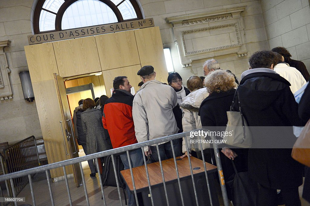 People queue to enter a room of the Paris' courthouse on March 11, 2013 on the second week of the trial of Leonide Kameneff, the founder of 'L'Ecole en bateau' and three of his crew members who are charged for raping 14 teenagers schooling on their boat between 1980 and 1990. Only nine of them filed a complaint due to France's prescription rules .
