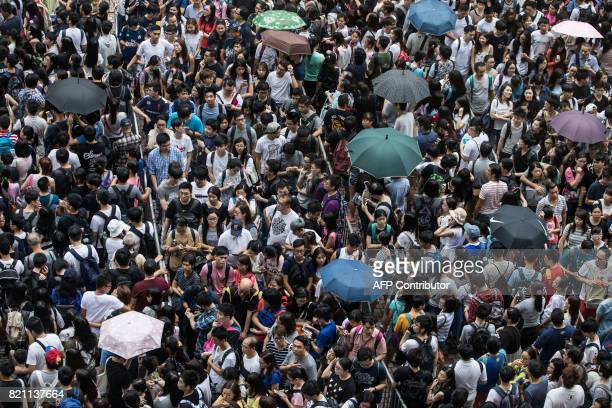 People queue to enter the International Book Fair in Hong Kong on July 23 2017 This year's book fair held at the Hong Kong Exhibition and Convention...