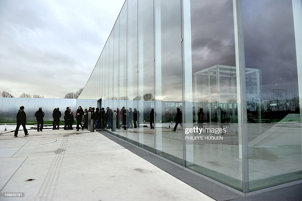 People queue to enter the Louvre-Lens museum on December 31, 2012 in Lens, northern France. Three weeks after its inauguration, the museum welcomed its 100.000th visitor on December 28, 2012.