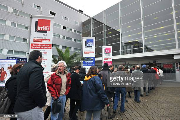 People queue to enter the Nantes city congress on January 29 in Nantes western France during the 15th edition of the music festival 'La Folle...