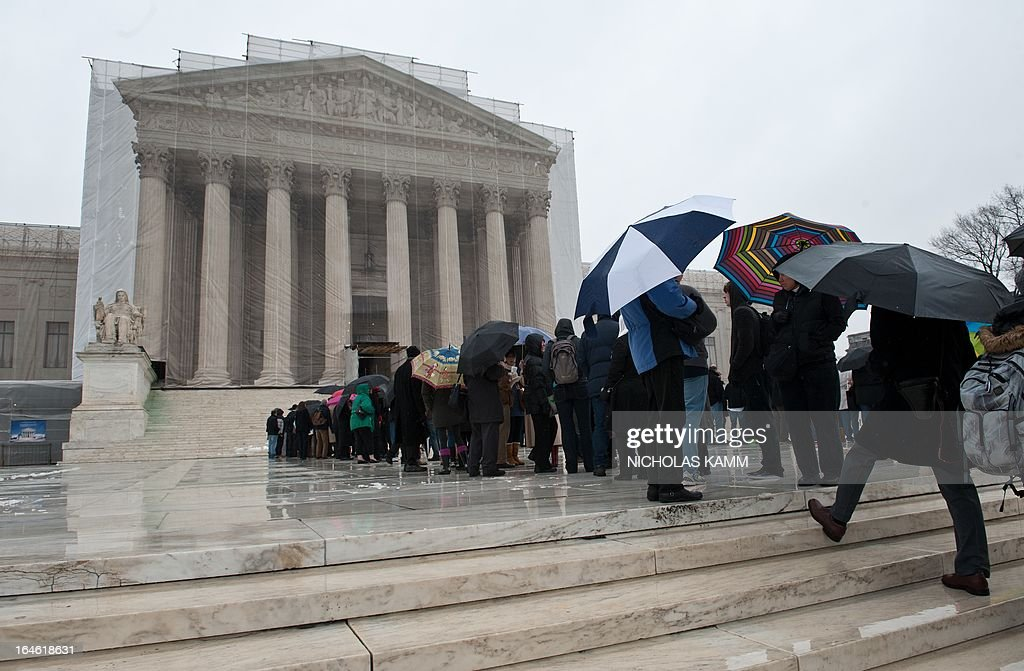 People queue to enter the Supreme Court in Washington on March 25, 2013. The justices will hear arguments on March 26 on California's Proposition 8 ban on same-sex marriage and on March 27 on the federal Defense of Marriage Act, which defines marriage as between one man and one woman. AFP PHOTO/Nicholas KAMM