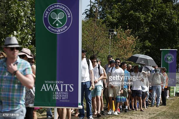 People queue to get into The All England Tennis Club on day three of the 2015 Wimbledon Championships in Wimbledon southwest London on July 1 2015...
