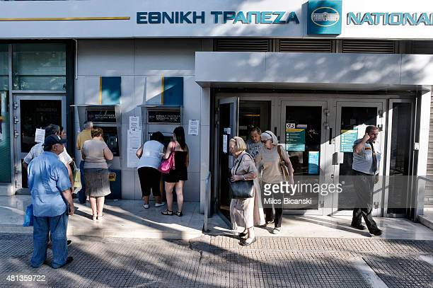 People queue to get money from ATMs as Greek banks reopened on Monday morning after three weeks of closure on July 20 2015 in Athens Greece Many...