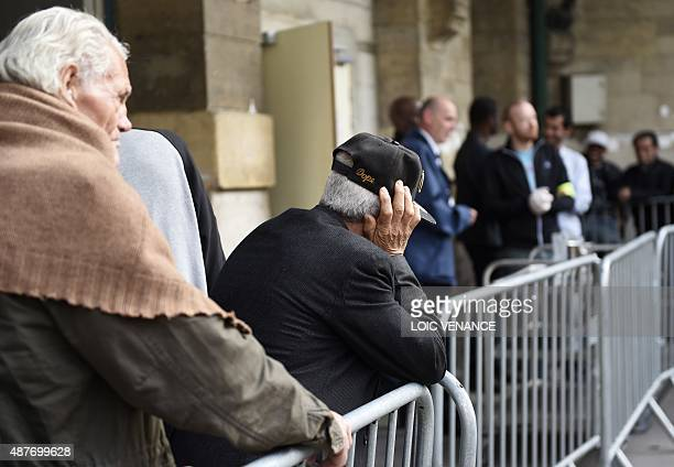 People queue to receive a meal at a 'Armee du Salut' center on September 8 2015 in Paris On September 11 the foundation celebrates its 150th...