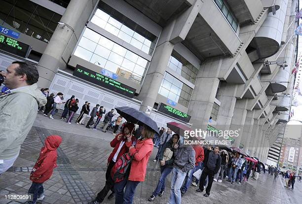 People queue to see a replica of the King's Cup on display at the museum of the Santiago Bernabeu stadium in Madrid on April 22 2011 Real Madrid has...
