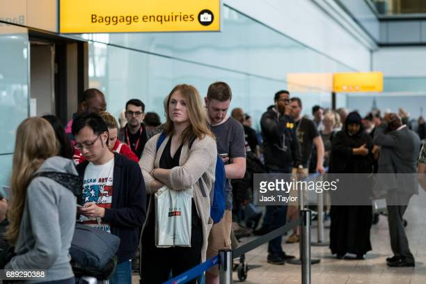 People queue to speak to British Airways representatives at Heathrow Airport Terminal 5 on May 28 2017 in London England Thousands of passengers face...