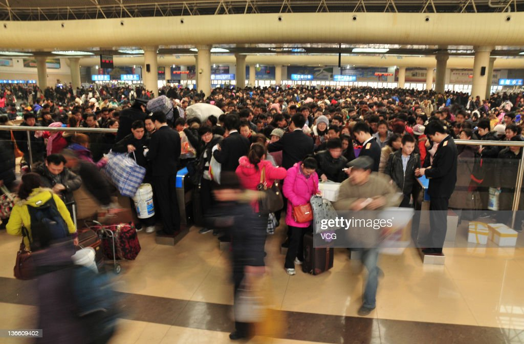 People queue to take trains home at Dalian Railway Station on January 8, 2012 in Dalian, China. China's annual Spring Festival travel rush begins today as authorities estimate 3.158 billion passenger journeys will be made for the Chinese lunar new year during the 40-day travel period.