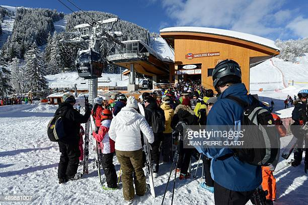 People queue to use a cable car in the French ski resort of Meribel French Alps on February 17 on the first day of the French February holidays AFP...