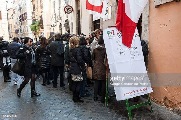 People queue to vote during the PD primary elections on December 8 2013 in Rome Italy Italians are voting today to elect the new leader of the...