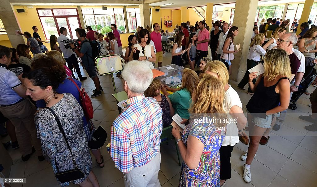 People queue to vote in Spains general election at the Bernadette college polling station in Moncloa-Aravaca, Madrid, on June 26, 2016. Spain votes today, six months after an inconclusive election which saw parties unable to agree on a coalition government. JORDAN