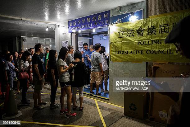 People queue to vote shortly before polls officialy close during the Legislative Council election in Hong Kong late on September 4 2016 Young Hong...