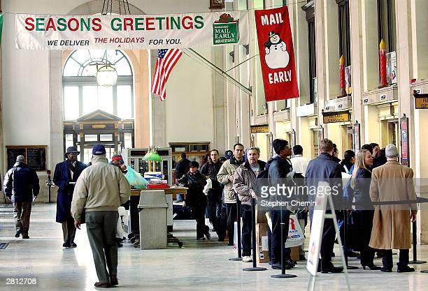 People queue up at the Manhattan's General Post Office December 15 2003 in New York City The Monday of the week before Christmas is traditionally the...