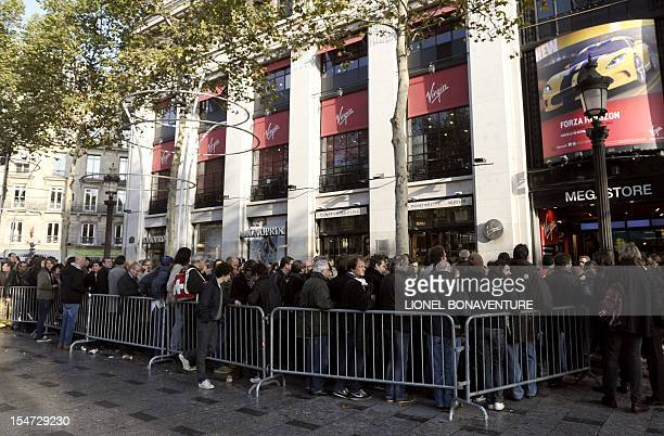 People queue up at the Virgin megastore in Paris on October 25 2012 to buy tickets for a concert held the same day in the French capital by British...