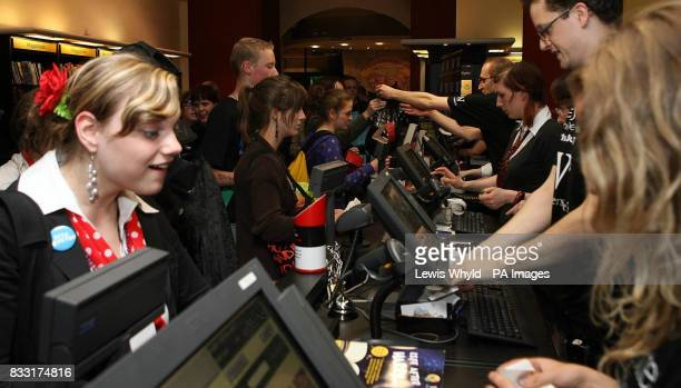 People queue up at Waterstones bookshop on Piccadilly London as they at opened at midnight to sell copies of Harry Potter and the Deathly Hallows the...