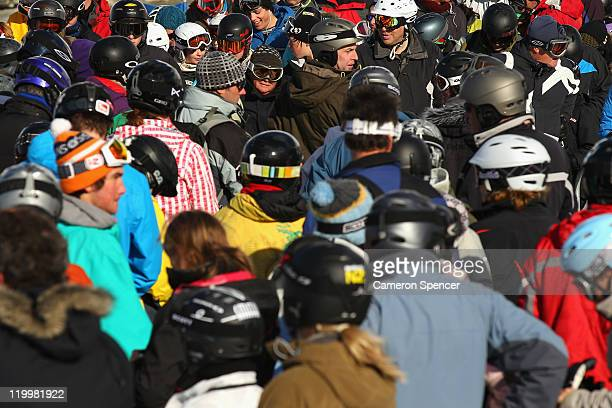 People queue up for a chairlift at Treble Cone ski resort on July 28 2011 in Wanaka New Zealand