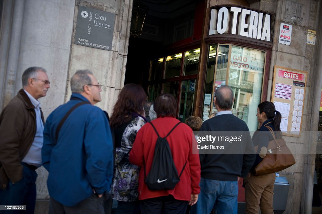 People queue up for buying lottery at a lottery shop on November 9, 2011 in downtown Barcelona, Spain. The current Eurozone debt crisis has left Spain with crippling economic problems. Mounting debts, record unemployment figures and the recent credit rating downgrade is leaving the country facing further economic stagnation. The people of Spain are preparing to go to the polls for a general election which will be held on November 20, 2011.