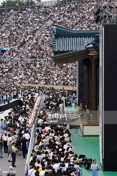 People queue up for mourning actor Yujiro Ishihara's 23rd Buddhist memorial service at the National Stadium on July 5 2009 in Tokyo Japan Yujiro...