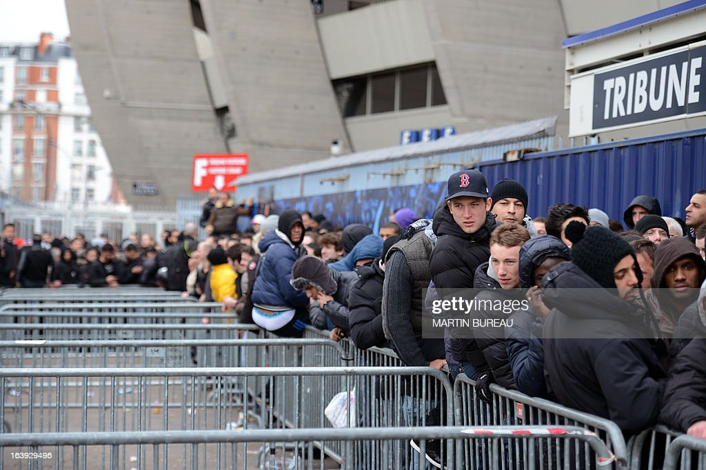 People queue up in front of the Paris Parc des Princes stadium, on March 18, 2013 in Paris, to buy tickets to attend the Champions League quarter final match between Paris Saint-Germain and FC Barcelone scheduled on April 2, in this stadium.