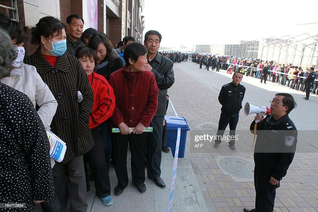 People queue up outside a gas station to buy natural gas in Lanzhou, northwest China's Gansu province, on March 27, 2013 fearing the price will rise in April. China's Price Watchdag denied the rumor sweeping the media that the gas price will rise by one yuan per cubic meter in April, state media reported. CHINA