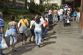 People queue up outside a supermarket on January 29 2015 in Caracas due to a long term shortage in Venezuela Sliding oil prices have sent Venezuela...