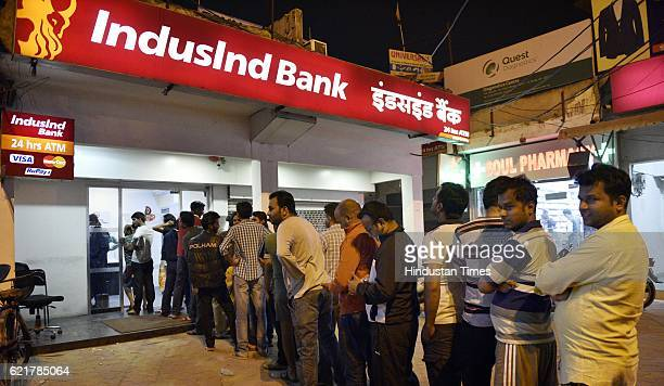 People queue up outside ATMs to withdraw hundred rupee notes at sector 12 on November 8 2016 in Noida India Prime Minister Narendra Modi in his...
