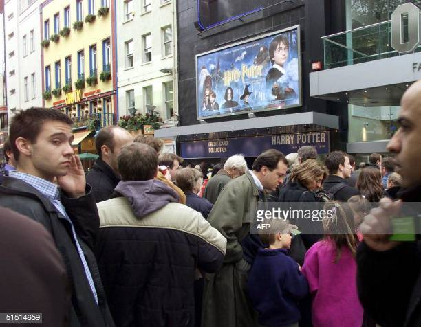 People queue up outside the Odeon cinema in Leicester Square for the first public showing of the Harry Potter movie in London's west end 16 November...