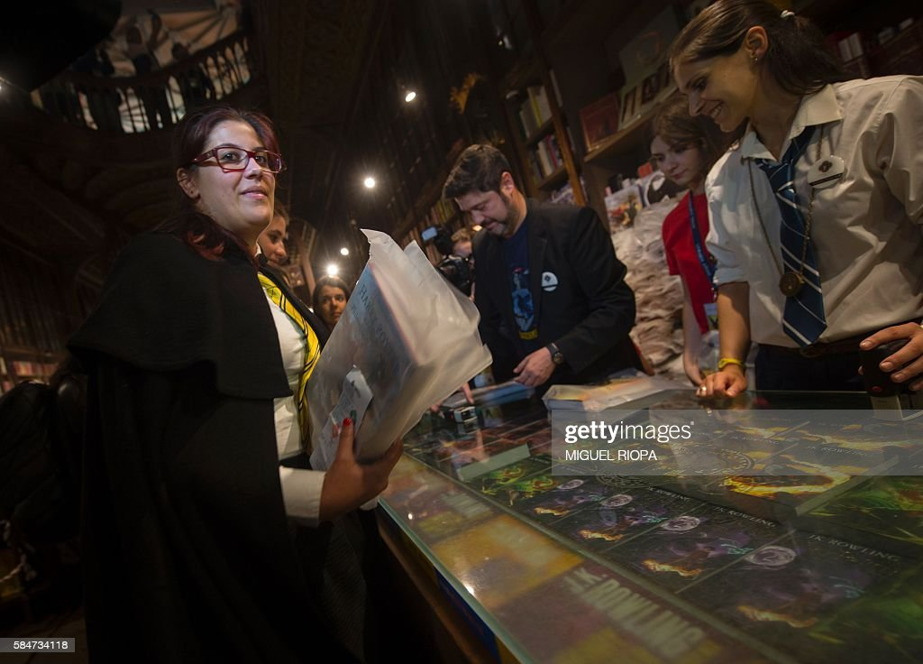 People queue up to purchase copies of British author JK Rowlings latest book in the Potter series Harry Potter and the Cursed Child on July 31 2016...