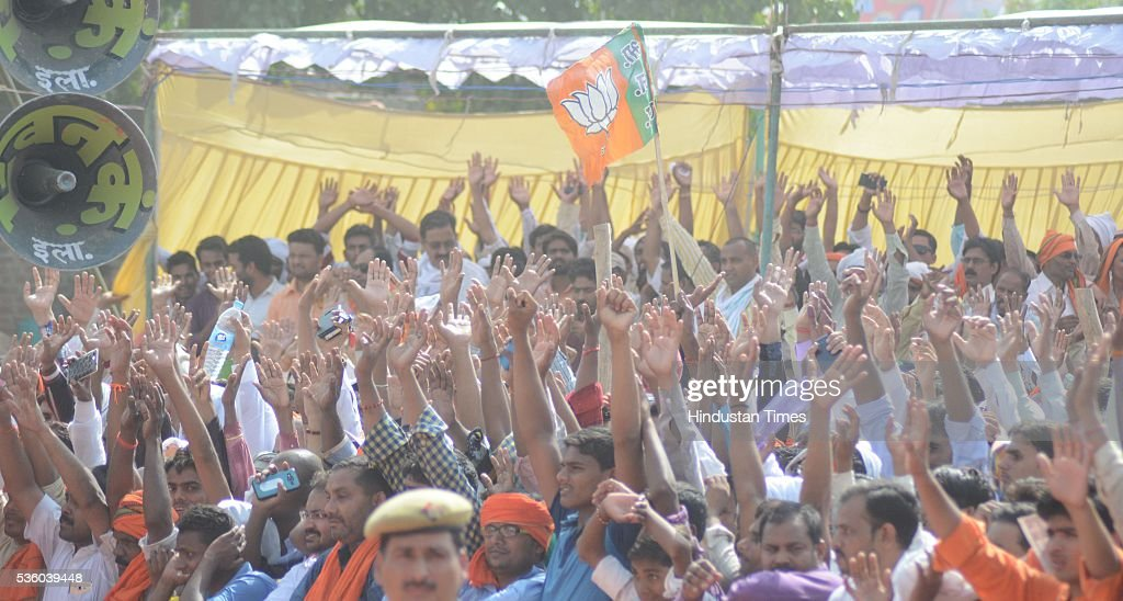 People raise hands while listening to BJP National President Amit Shah during the Sardar Patel Kisan Mahasammelan at Andawa area in Jhunsi on May 31, 2016 in Allahabad, India. On his way to rally, BJP chief Amit Shah had lunch with Dalit and backward class members in a dusty village in Varanasi. The event was not elaborate but the symbolism was hard to miss that party is reaching out to caste groups not counted among its core supporters ahead of the crucial 2017 assembly election in Uttar Pradesh.