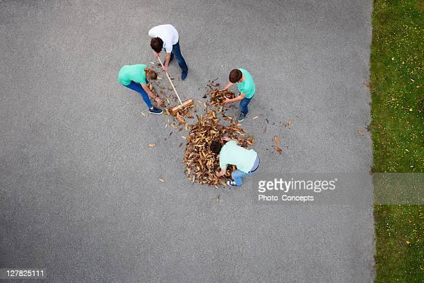 People raking leaves