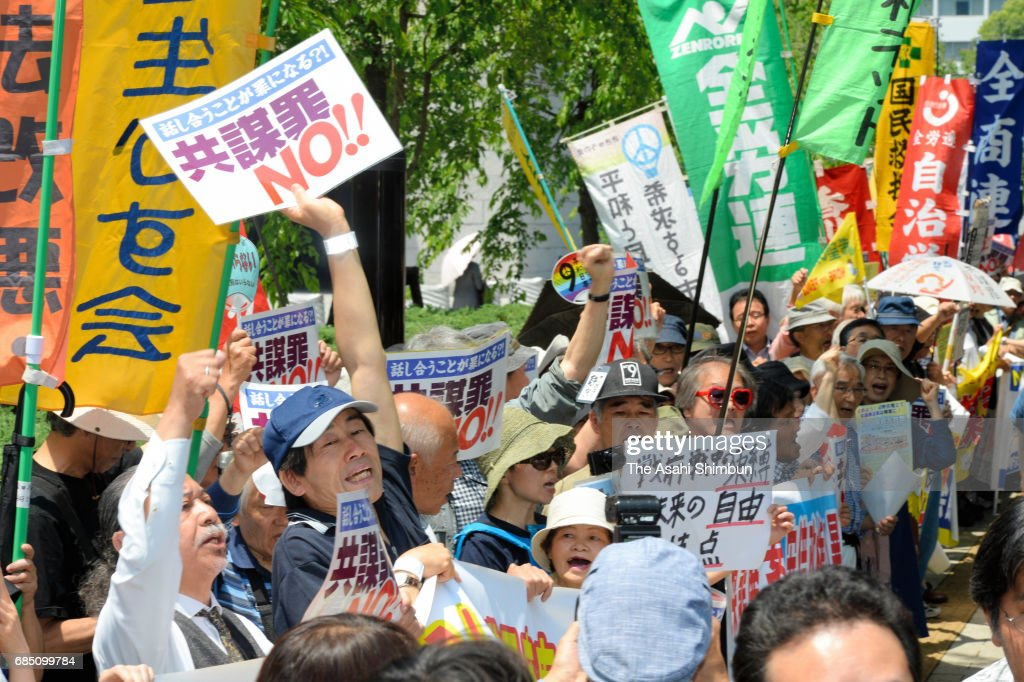 People rally against the anti-conspiracy legislation in front of the diet building on May 19, 2017 in Tokyo, Japan. Opposition parties are trying to block passage, saying the legislation could lead to human rights violations concerning freedom of thought and conscience. The legislation covers 277 crimes and would make illegal even the planning or discussing of those possible crimes among members of an organized group. The government has said passage of the legislation was a precondition for Japan joining the U.N. Convention against Transnational Organized Crime (TOC). It has also said the proposed law would make Japan safer during the 2020 Tokyo Summer Olympics.