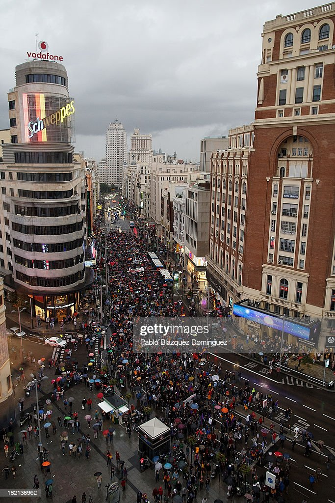 People rally during a demonstration against the Spanish Monarchy at Gran Via Street on September 28, 2013 in Madrid, Spain. Organizers call for a demonstration on the anniversary of 'Surround the congress protest' to claim the abolition of the Monarchy. Currently King Juan Carlos of Spain is in hospital recovering from a hip operation. The Spanish Royal Family has lost popularity since the King injured his hip on elephant hunting trip and the King's son-in-law, Inaki Urdangarin is being investigated over a corruption scandal.