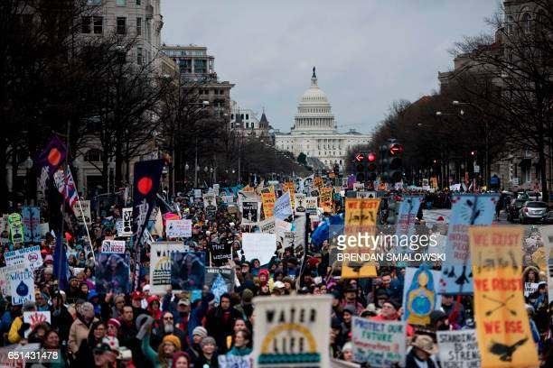 TOPSHOT People rally during the Native Nations Rise protest on March 10 2017 in Washington DC Native tribes from around the US gathered for four days...