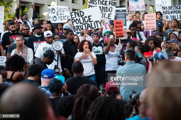 TOPSHOT People rally in Dallas Texas on Thursday July 7 2016 to protest the deaths of Alton Sterling and Philando Castile Black motorist Philando...