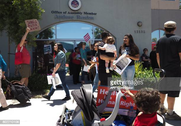 People rally in favor of singlepayer healthcare for all Californians as the US Senate prepares to vote on the Senate GOP health care bill outside the...